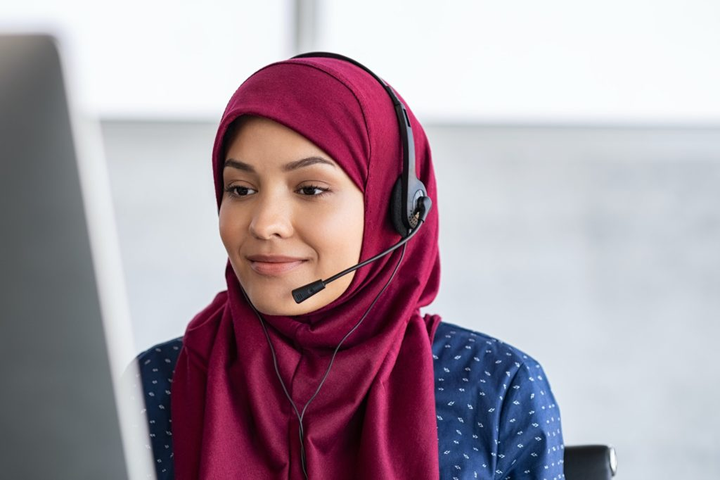 Islamic woman with hijab in call center